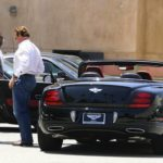 Arnold Schwarzenegger with Bentley Continental Supersports image.