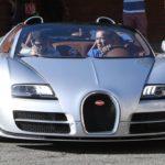 Arnold Schwarzenegger with Bugatti Veyron Vitesse image.
