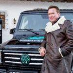 Arnold Schwarzenegger with Mercedes electric G-Wagen image.