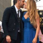 Blake Lively and her husband Ryan Reynolds kissing