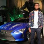 Chardick Boseman with car Lexus