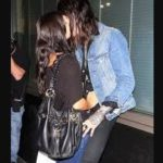 Demi Lovato and Trace Cyrus kissing