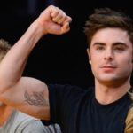 Zac Efron did Feather tattoo on his right hand biceps