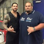 Roman Reigns with his brother Matthew Anoa'i