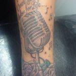 Tulisa Contostavlos tattooed vintage mic on her left wrist