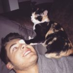 Cody Christian with his pet cat
