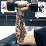 Adam Cole has a fire tattoo in his right hand image.