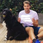 Alex Carey with his pet dog
