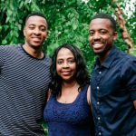 CJ McCollum with mother and brother