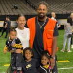 Cameron Jordan and his wife with his children