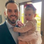 Mike Moustakas with his little daughter Marigold Ruth Moustakas