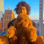 Robin Lopez with his pet dog