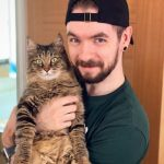 Jacksepticeye with his pet cat