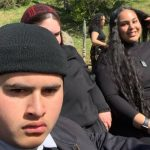 Julian Dennison with his sisters