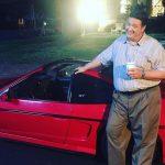 Lance Barber with his ferrari car