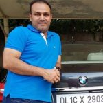 Virender Sehwag with his BMW Car