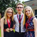 Aiden Flowers with his sisters