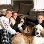 Austyn Johnson and her brother with her pet dog