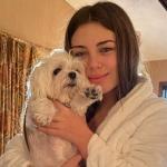 Caitlin Carmichael with her pet dog