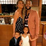 Chrissy Teigen with husbnad and kids