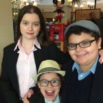 Dalila Bela with her brothers