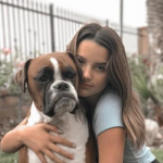 Jules LeBlanc with her pet dog