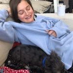 Georgie Henley with her pet dog