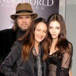 India Eisley with her parents