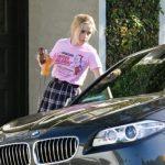 Kiernan Shipka with her BMW car