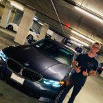 Nicholas Hamilton with his BMW Car
