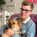 Nicholas Hamilton with his pet dog