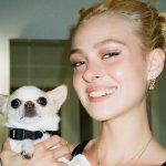 Nicola Peltz with her pet dog