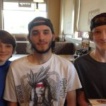 Toby Nichols with his brothers
