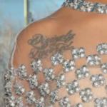Dominique Fishback's right solder tattoo