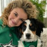 Mallory James Mahoney with her pet dog