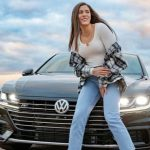 Kelsey Plum with her car