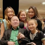 Sunisa Lee with her father, mother and sisters