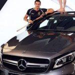 Timur Oruz with his Mercedes car